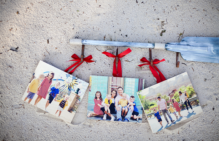 Pictured above: 3 – 11×14 PhotoBoards with red ribbon. Printed images by @molliejanephotography